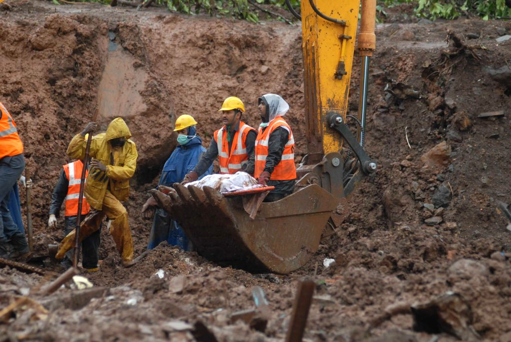 Rescue operations underway at Malin village, near Pune which was buried in a landslide, killing at least 31 people and trapping more than 160 on early Wednesday (30th July, 2014) morning; on July 31,