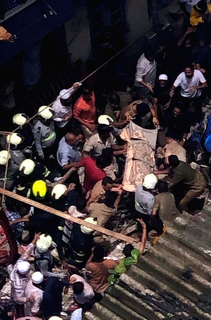 Rescue Operations underway at the four-storey Kesarbai Building in south Mumbai's Dongri area that collapsed at around 11.30 a.m, on July 16, 2019. Two people were killed and five others ...