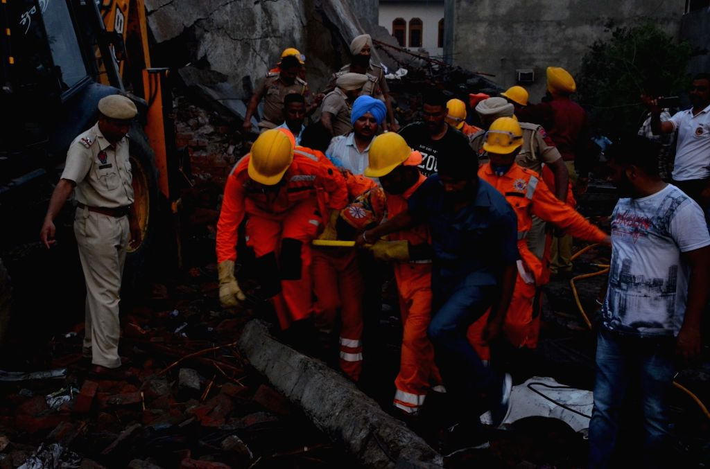 Rescue operations underway at the site of a blast at an unauthorized firecracker factory in a residential in Batala town of Punjab's Gurdaspur district on Sep 4, 2019. At least 19 people ...