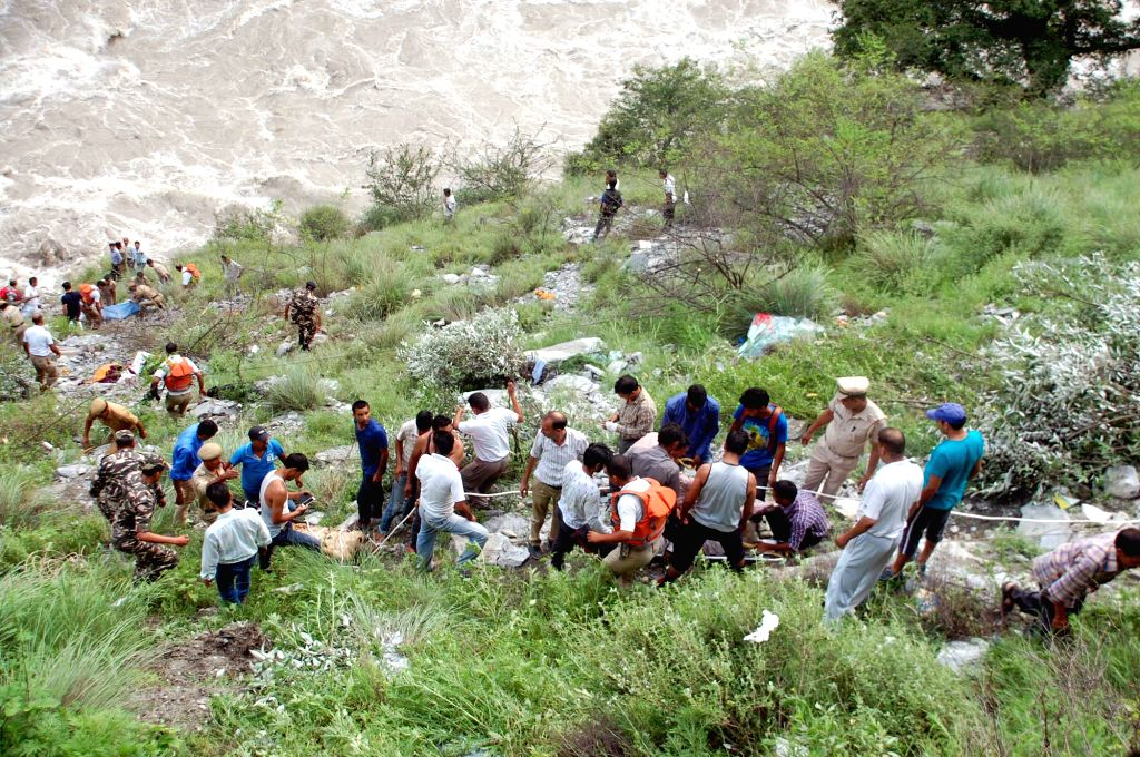 Rescue operations underway at the site where a tourist bus fell into the Parvati river in Kullu of Himachal Pradesh on July 23, 2015. Atleast six people were killed and  12 others injured in ...