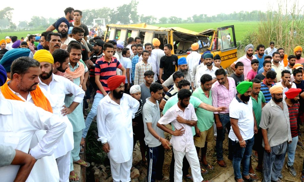 Rescue operations underway at the site where a school bus fell into a large drain in Muhawa village, 40 km away from Amritsar on Sept 20, 2016.