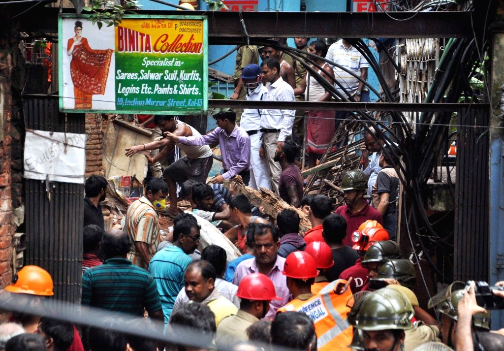 Rescue operations underway at the site where an old two-storeyed building partially collapsed in 10-B Indian Mirror Street of Kolkata on July 25, 2017. Many people are trapped in the ...
