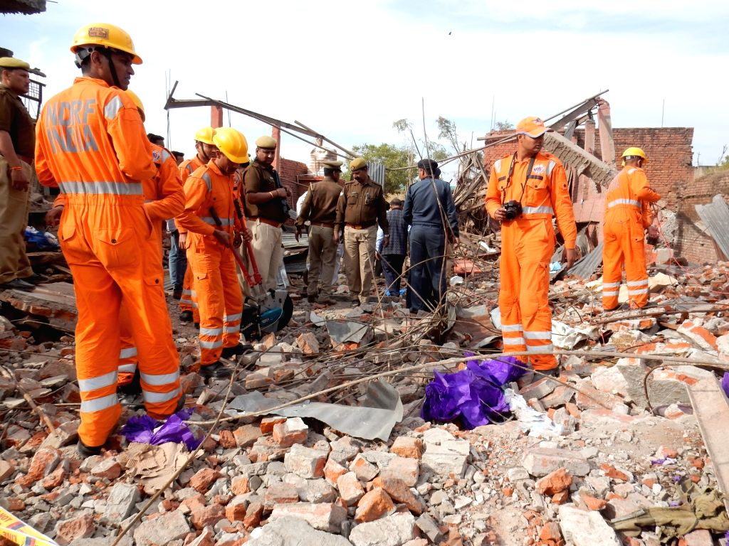 Rescue operations underway at the site where as many as 13 people were killed and a dozen others injured in a blast in Rothaan village of Uttar Pradesh's Bhadohi on Feb 23, 2019.