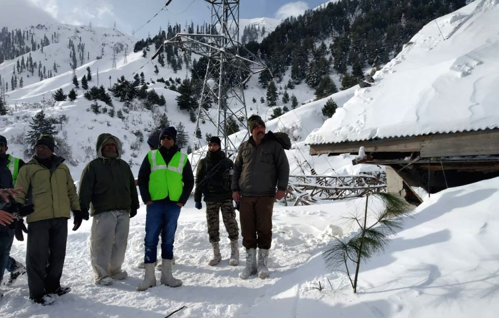 Rescue personnel near the Jawahar Tunnel where an avalanche hit a police post on the Jammu-Srinagar highway, on Feb 8, 2019. Ten people were reported missing after the avalanche. According ...