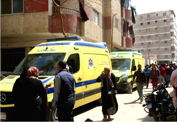 Rescue vehicles arrive at the site of a collapsed building in Cairo, Egypt, March 27, 2021.