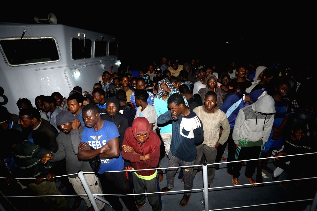 Rescued immigrants are seen at a naval base in Tripoli