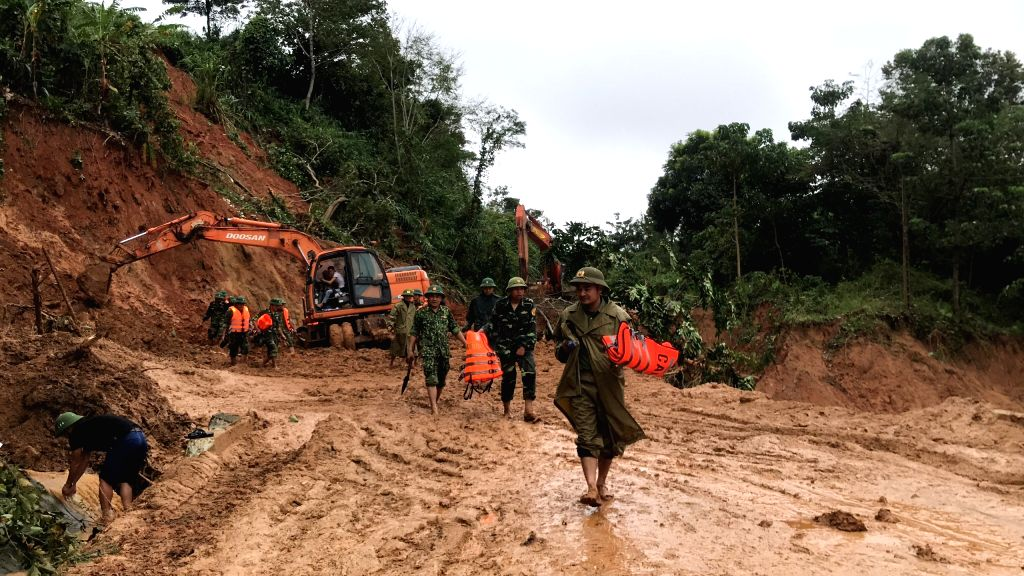 Rescuers are seen in the landslide site in central Vietnam's Quang Tri Province, Oct. 18, 2020. A landslide triggered by prolonged downpours has left three military ...
