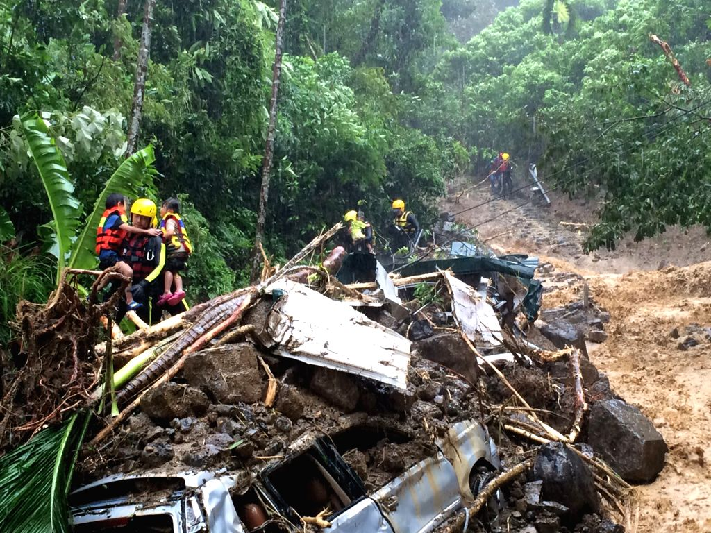 Rescuers evacuate trapped people in Xinbei City, southeast China's Taiwan, Aug. 8, 2015. Super typhoon Soudelor battered Taiwan after landing in Hualian on ...
