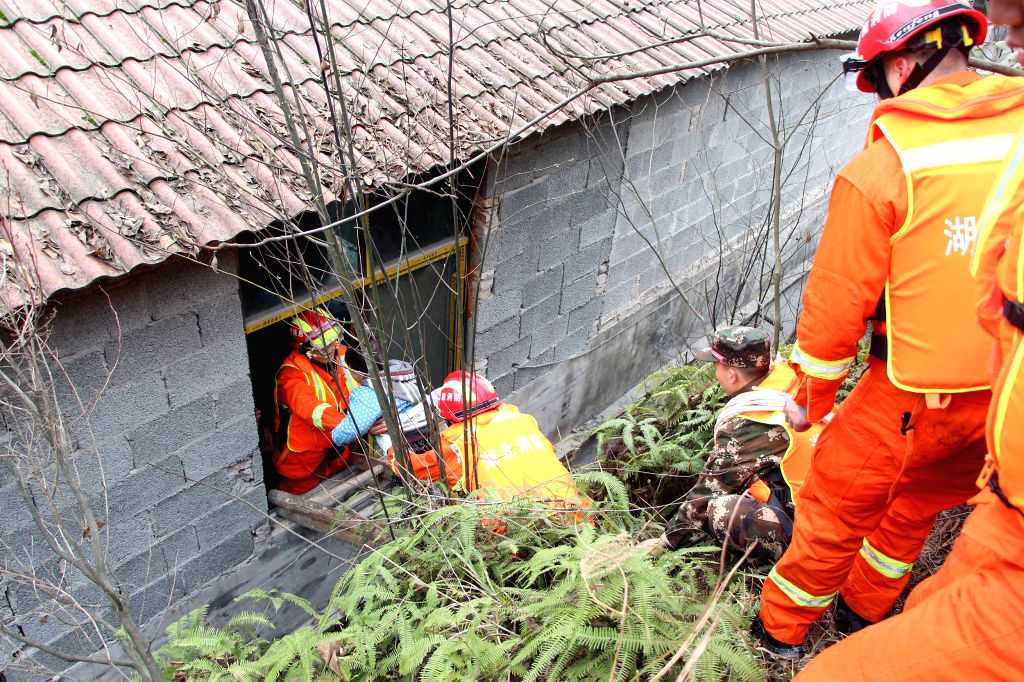 Rescuers evacuate villagers after the dike of a barrier lake collapsed in Longfeng Township of Enshi City, central China's Hubei Province, Jan. 14, 2016. The collapse ...