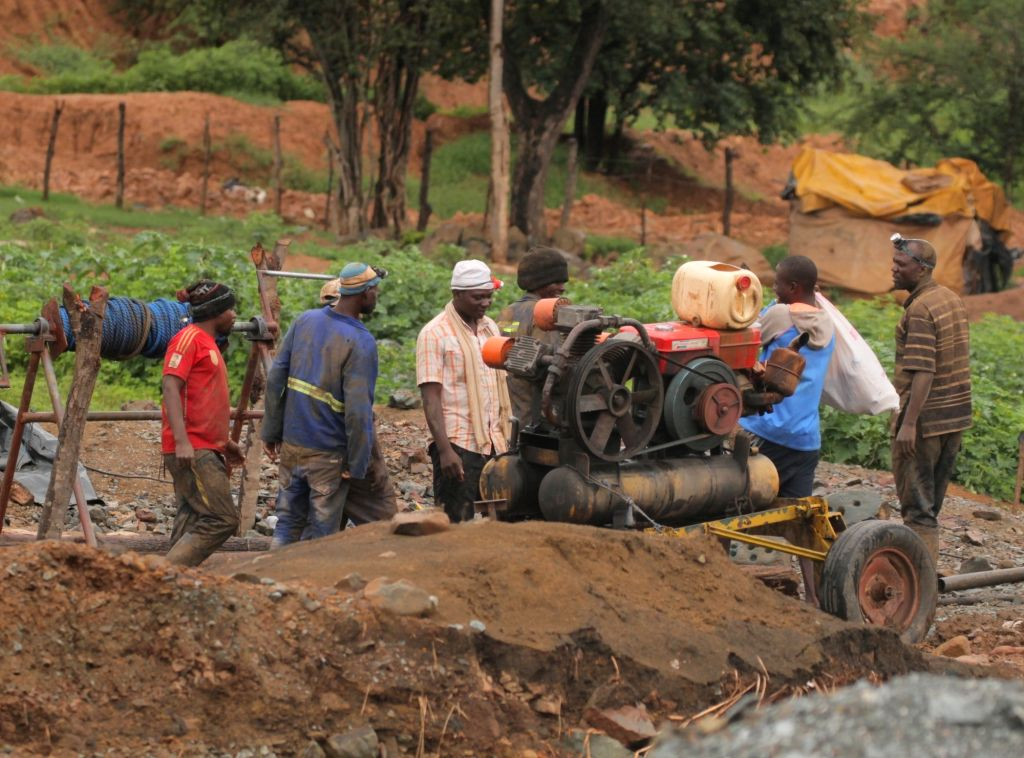 Rescuers start a generator at a mine in Battlefields, Mashonaland West Province, Zimbabwe, Feb. 16, 2019. Eleven illegal miners were rescued Saturday after ...