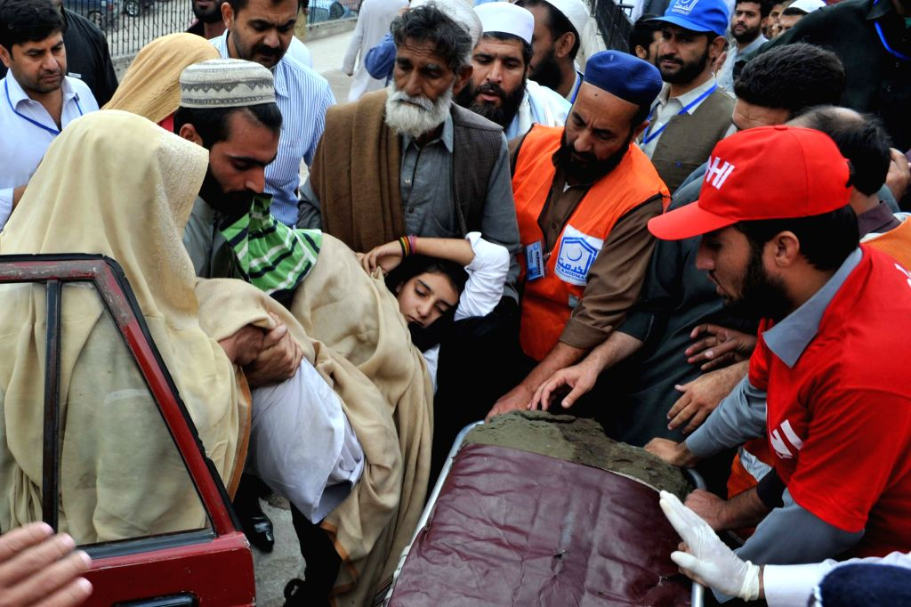Rescuers transfer a girl injured in an earthquake to a hospital in northwest Pakistan's Peshawar, Oct. 26, 2015. The Pakistani government and army has kicked off a ...