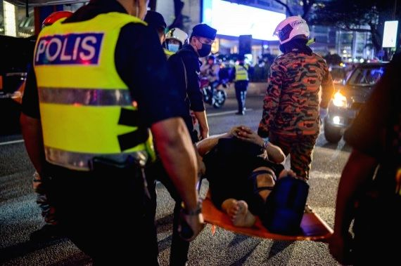 Rescuers transfer a passenger injured in a metro train collision in Kuala Lumpur, Malaysia, on May 24, 2021.