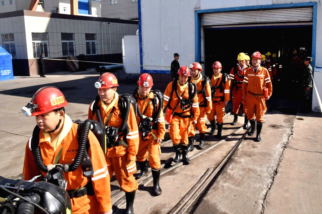 :Rescuers walk out the site of a rock burst accident in Yuncheng County, east China's Shandong Province, Oct. 27, 2018. As two more miners were confirmed ...