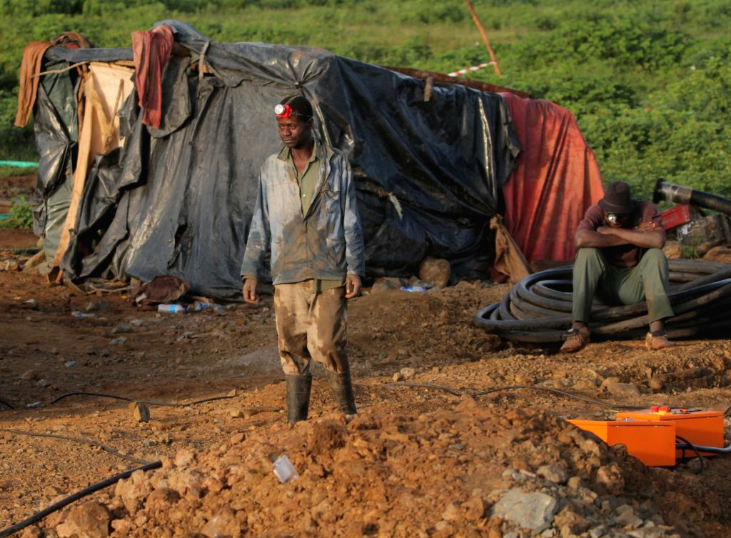 Rescuers work at a mine in Battlefields, Mashonaland West Province, Zimbabwe, Feb. 16, 2019. Eleven illegal miners were rescued Saturday after being ...