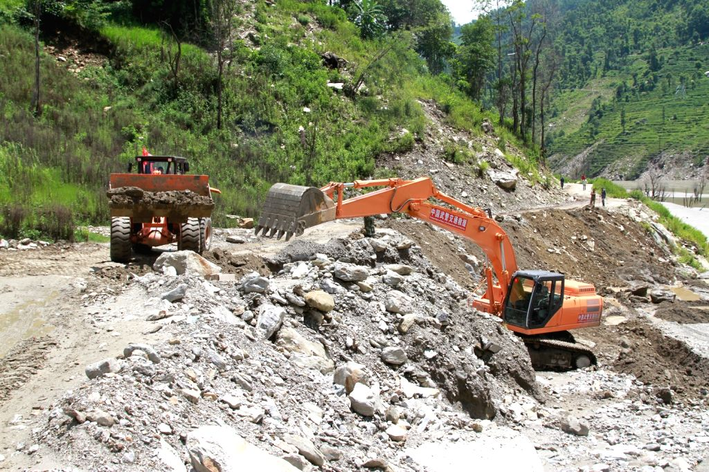 Rescuers work at the Nepalese section of China-Nepal Highway where the landslide happened, Aug. 5, 2015. An emergency squad of 100 Chinese armed police officers were ...