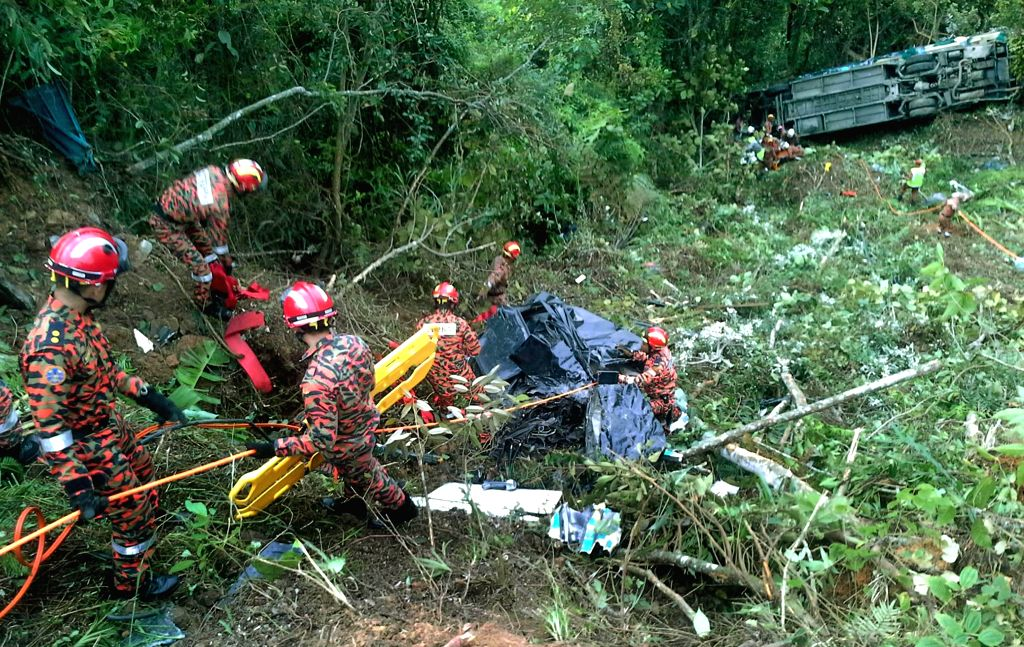 Rescuers work at the site of a traffic accident, which leaves three killed and 23 others injured, in the state of Sabah, Malaysia, on Dec. 1, 2015.