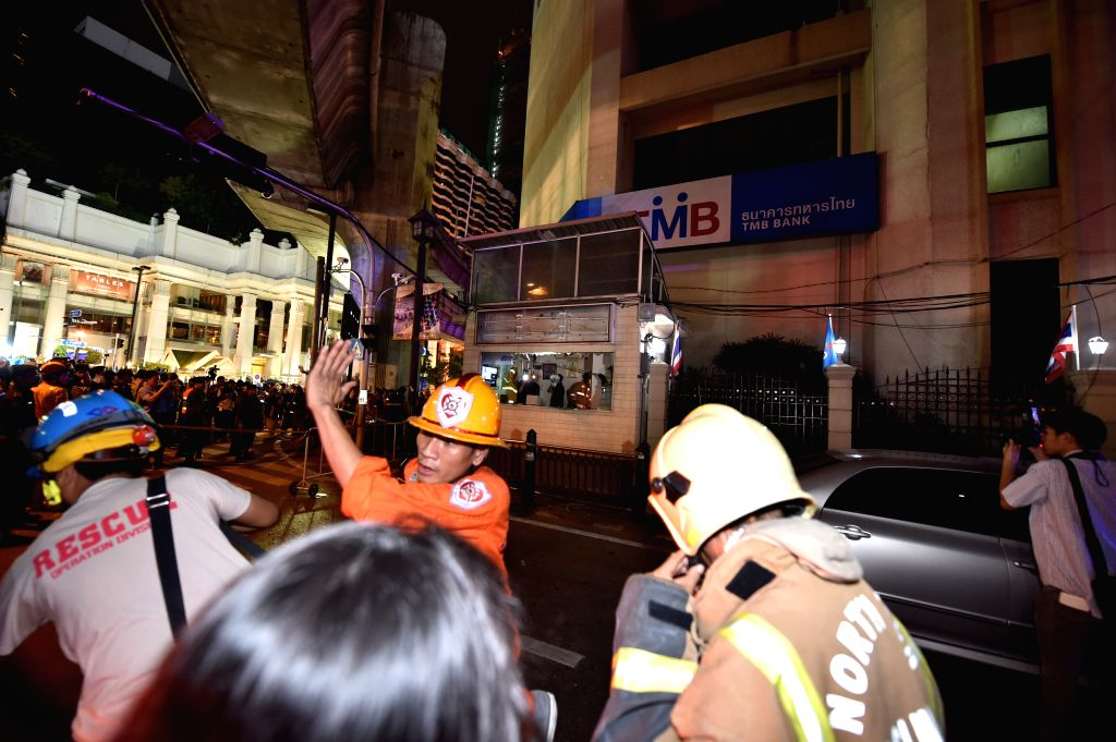 Rescuers work at the site of an explosion in downtown Bangkok, capital of Thailand, on Aug. 17, 2015. At least 15 people were killed and more than 80 others injured ...