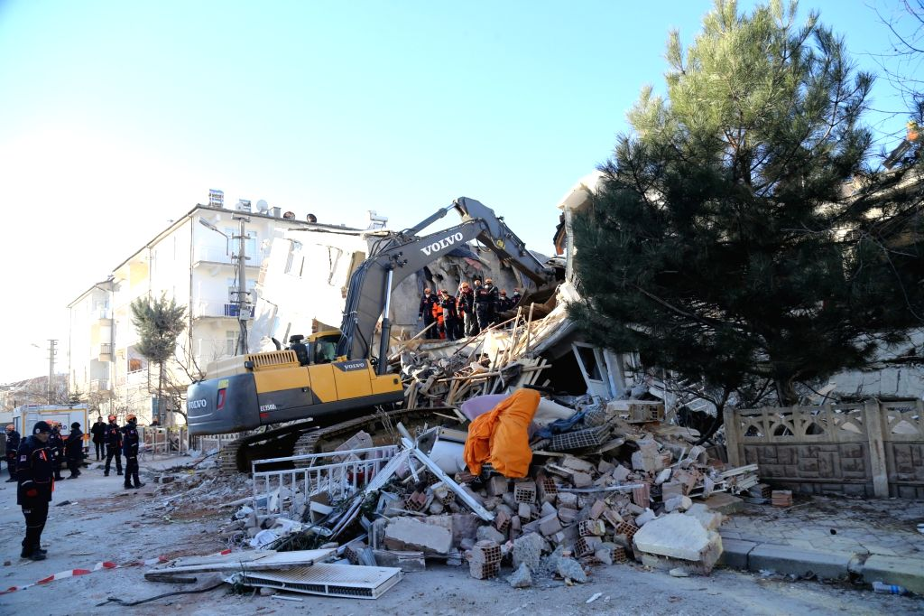 Rescuers work on the site after an earthquake in the province of Elazig, Turkey, Jan. 25, 2020. At least 20 people have been killed and 1,015 others wounded in a ...