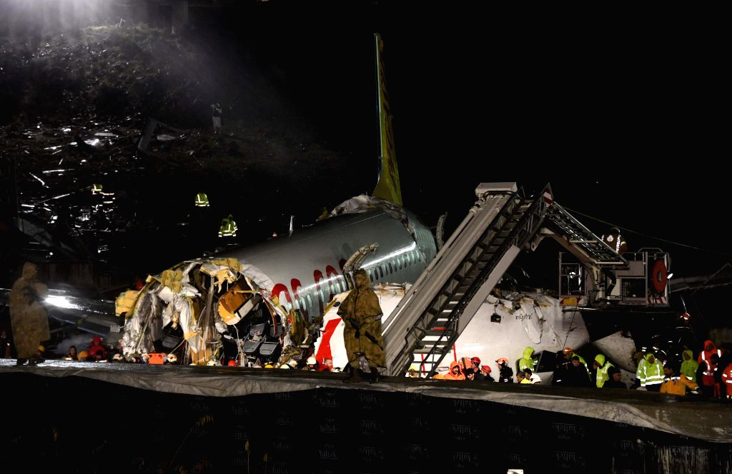 Rescuers work on the site of a plane sliding off the runway at Istanbul's Sabiha Gokcen International Airport, Turkey, on Feb. 5, 2020. At least 120 people were ...