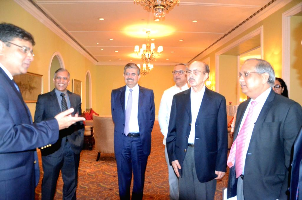 """Reserve Bank of India Governor Urjit Patel in a conversation with National Foundation for Corporate Governance managing trustee Chandrajit Banerjee and others during the """"National ... - Urjit Patel and Chandrajit Banerjee"""