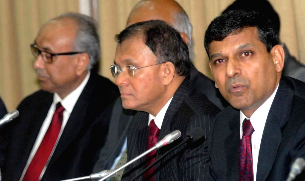 Reserve Bank of India (RBI) Governor Raghuram Rajan with RBI Deputy Governors H.R. Khan and S S Mundra during a press conference in Mumbai on Aug 5, 2014. - R. Khan