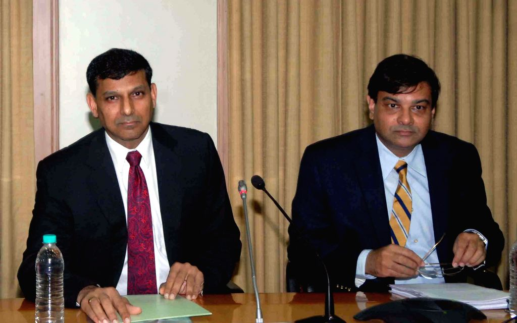Reserve Bank of India (RBI) Governor Raghuram Rajan with RBI Deputy Governor Urjit Patel during a press conference in Mumbai on Aug 5, 2014. - Urjit Patel