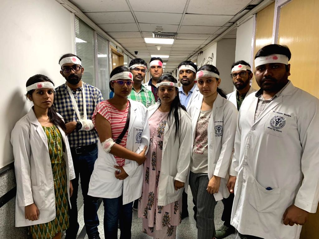 Resident doctors of All India Institute of Medical Sciences (AIIMS) wear bandages on their heads as they stage a demonstration against the recent attack on doctors in Kolkata; in New Delhi ...