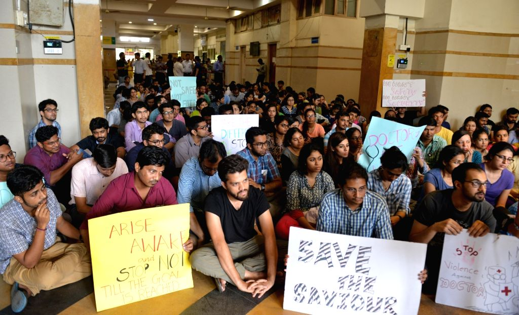 Resident doctors stage a demonstration to press for better security for doctors after two doctors of JJ Hospital were beaten up by relatives of a patient who died while undergoing a surgery ...
