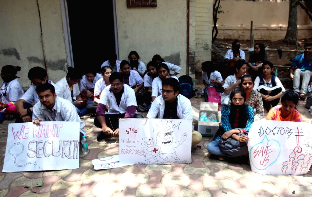 Resident doctors stage a sit-in demonstration during a day long strike against alleged attack on two resident doctors at JJ Hospital by a patient's family in Mumbai, on May 21, 2018.