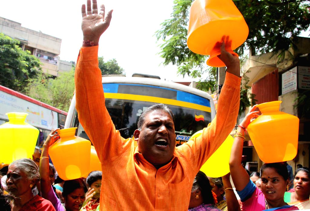 Residents of Bharati Nagara protest against Bangalore Water Supply And Sewerage Board (BWSSB) at Cox Town in Bangalore on June 26, 2014.