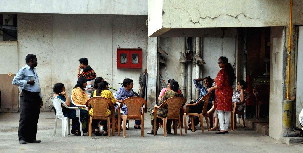 Residents of Campa Cola compound chat in the compound on the eve of its demolition in Mumbai on June 19, 2014.