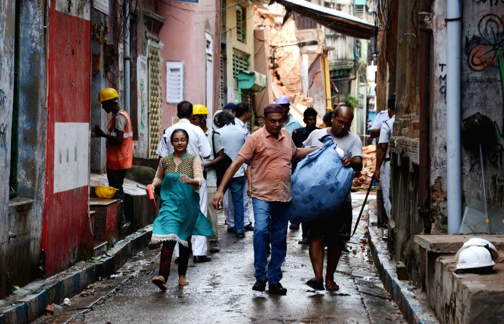 Residents of Central Kolkata's Bowbazar area whose houses got damaged during underground tunnelling work for the East-West Metro Project, shift to alternative accommodation on Sep 5, 2019.