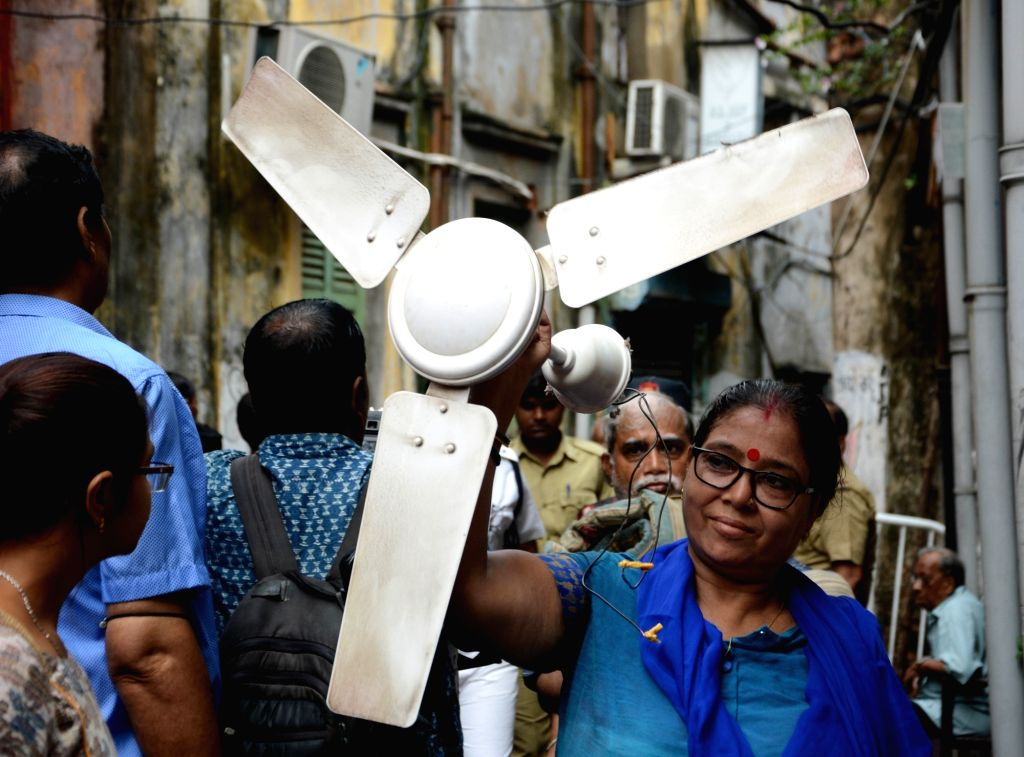 Residents of Central Kolkata's Bowbazar area whose houses got damaged during underground tunnelling work for the East-West Metro Project, carry their belongings as they are being evacuated ...