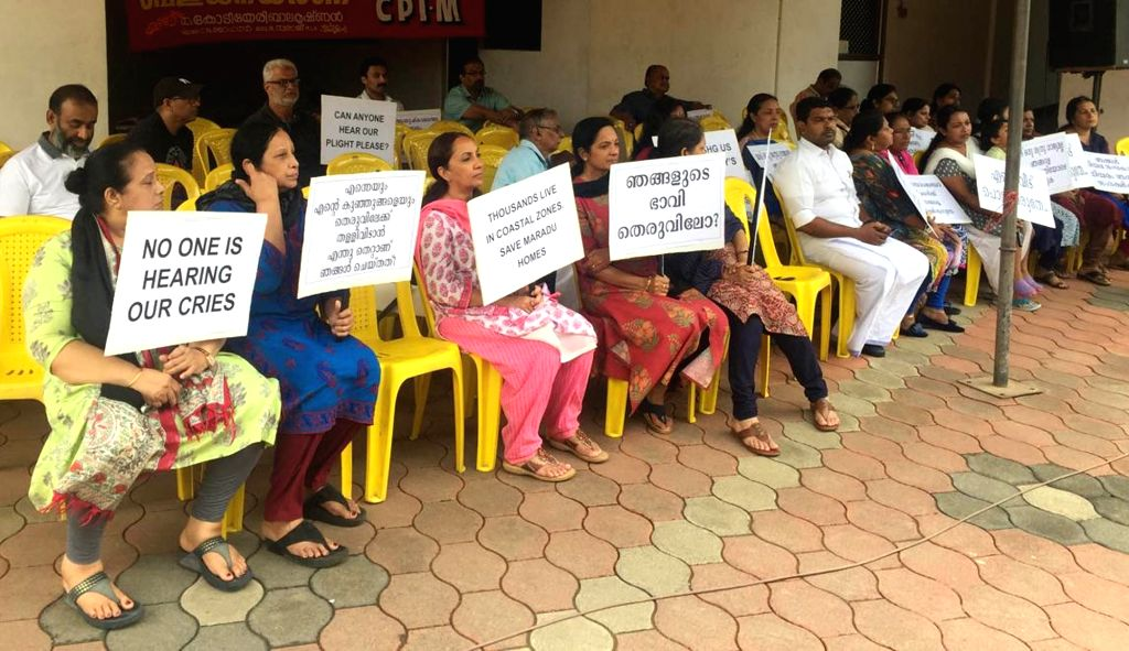 Residents of the various flats, which have been ordered to be demolished by the Supreme Court stage a demonstration in front of Holy Faith apartment in Kerala's Maradu on Sep 15, 2019.