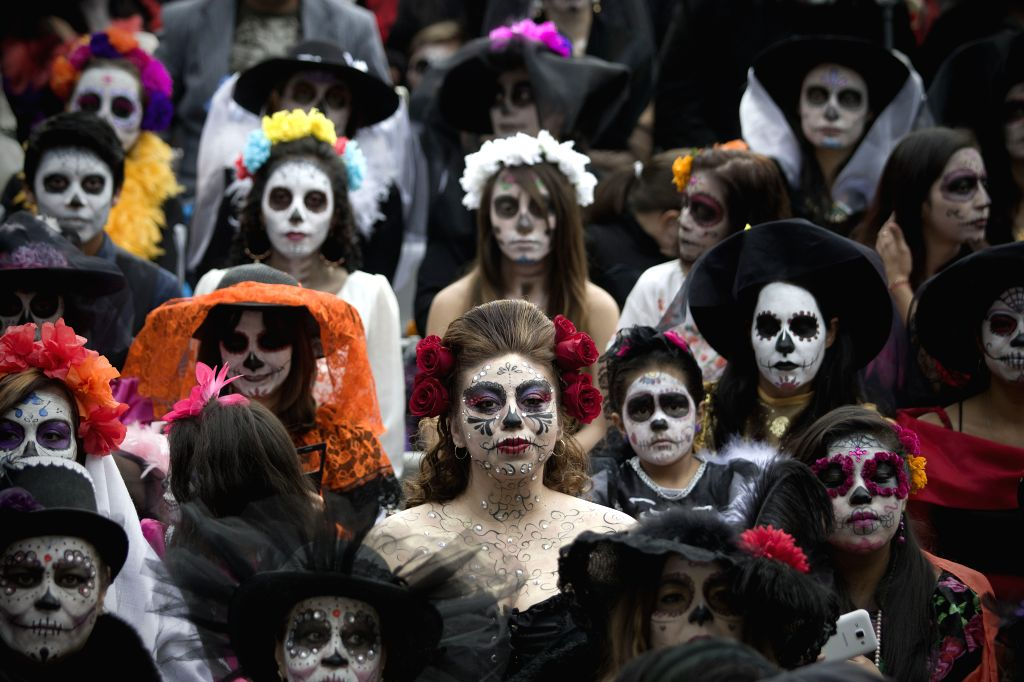 """Residents pose during the """"La Catrina Fest MX 2015"""", in Mexico City, capital of Mexico, on Nov. 1, 2015. According to the organizers, La Catrina Fest ..."""
