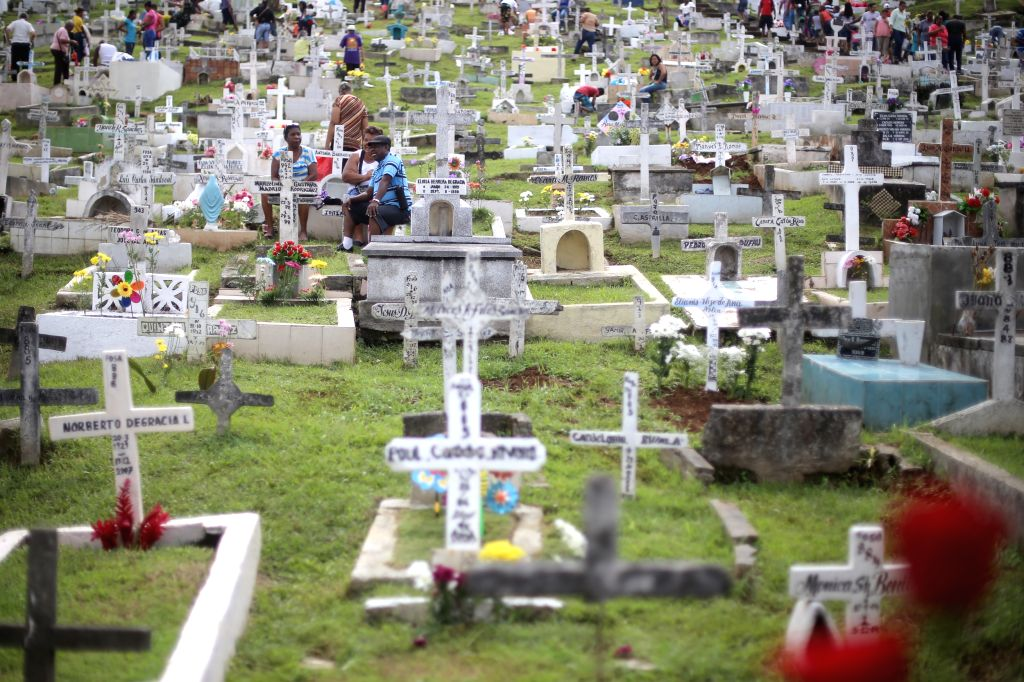 "Residents visit the tombs of their loved ones during ""The Day of the Dead"", at Pueblo Nuevo Cemetery, in Panama City, capital of Panama, on Nov. 2, ..."