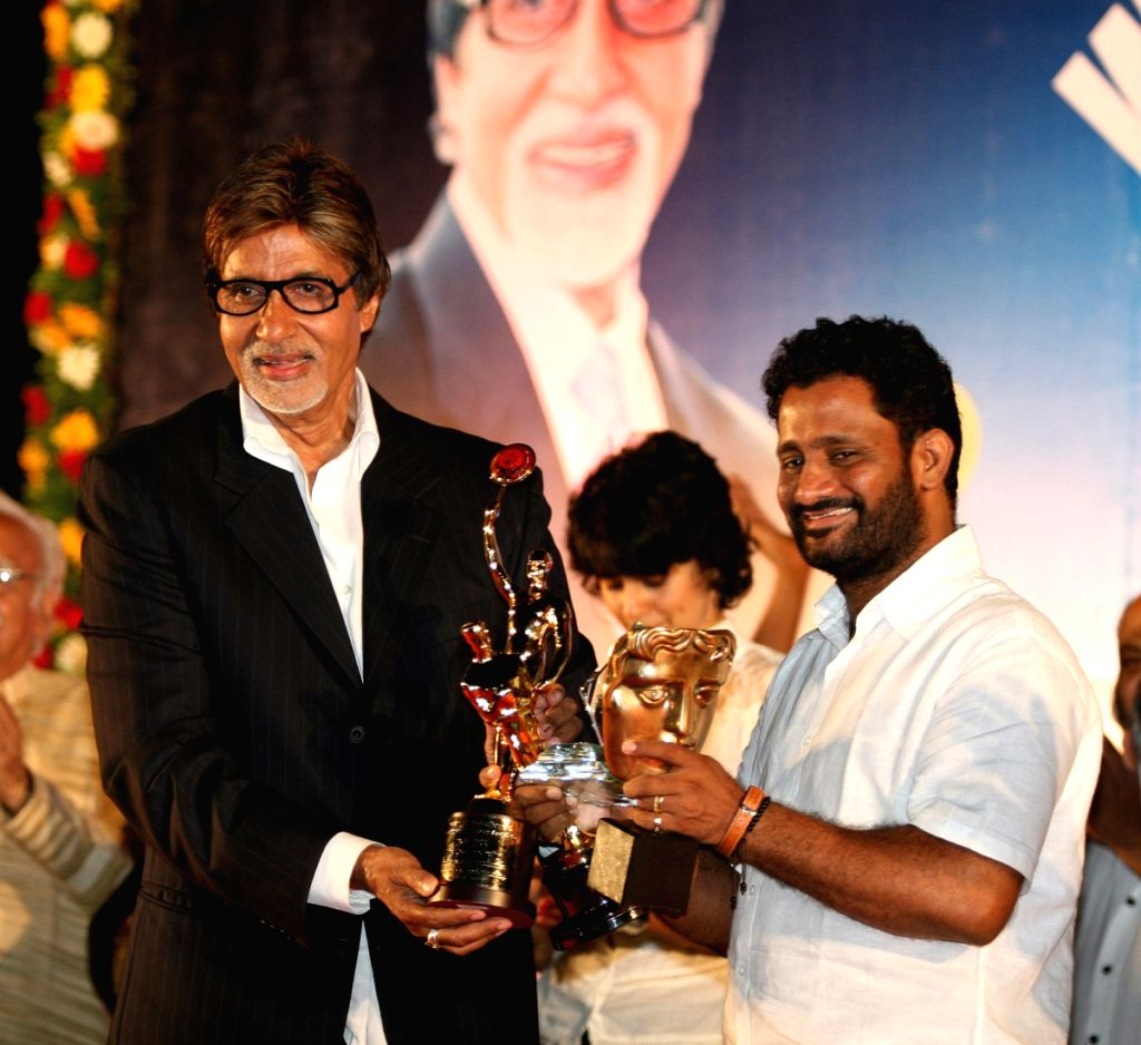 Resul Pukootty is ecstatic as he displays all his awards during an award ceremony in which he was awarded by Amitabh Bachchan for his contribution to sound industry on behalf of  Western India Motion