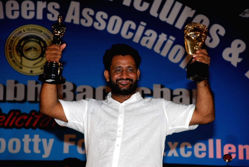 Resul Pukootty is ecstatic as he displays his Oscar and Bafta awards after recieving an award from Amitabh Bachchan for his contribution to sound industry on behalf of  Western India Motion Pictures &