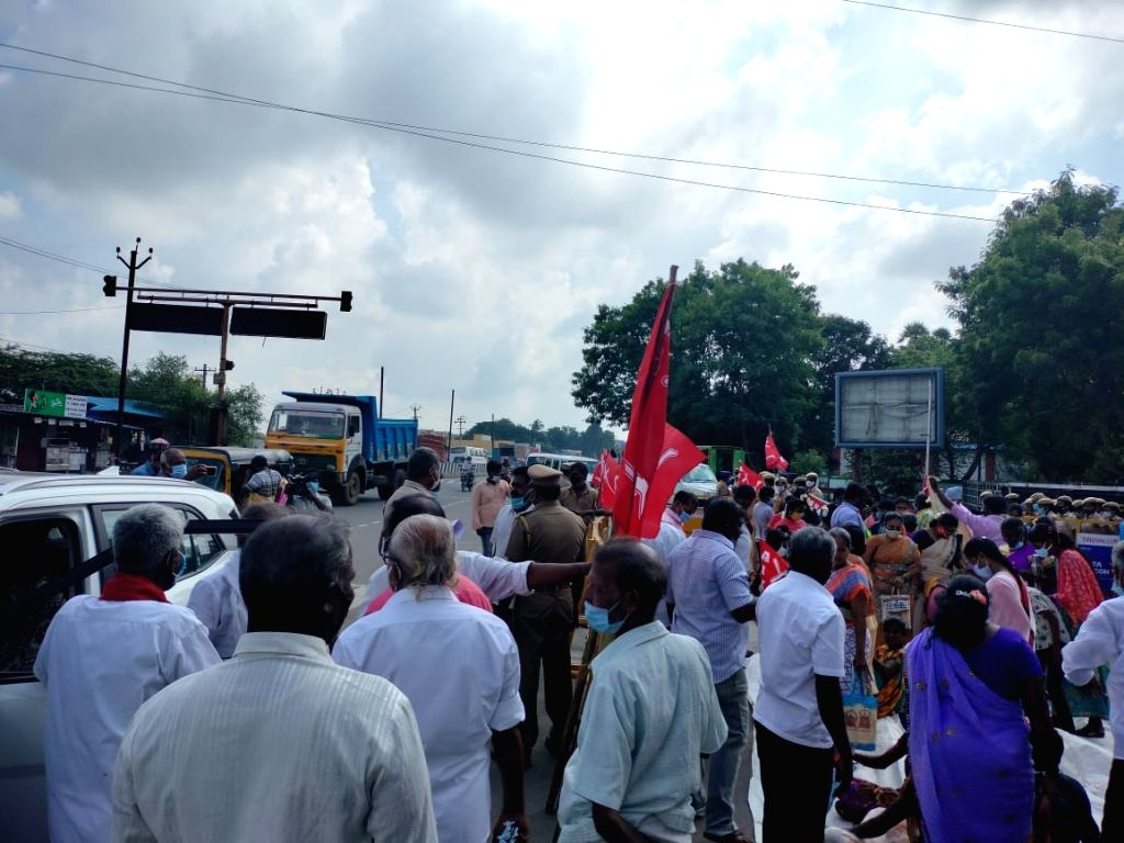 Retrenched car plant workers begin indefinite sit-in protest, demand land or job.