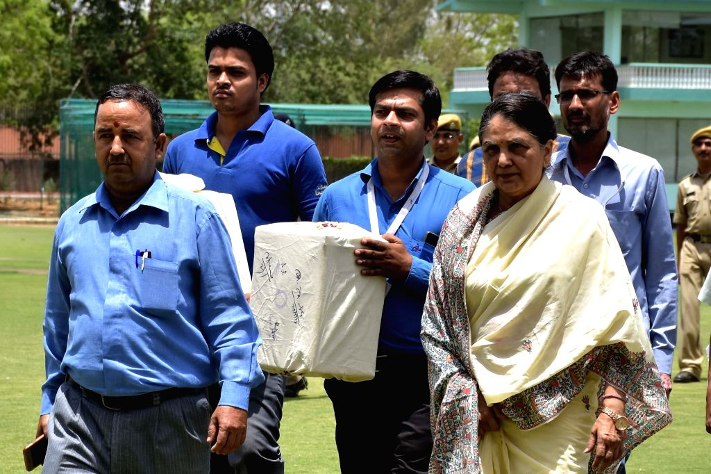Returning officers A K Pande and Justice Justice (Retd) Gyan Sudha Misra former Supreme Court Judge accompanied by other officials take the ballot boxes after completion of elections for the ...