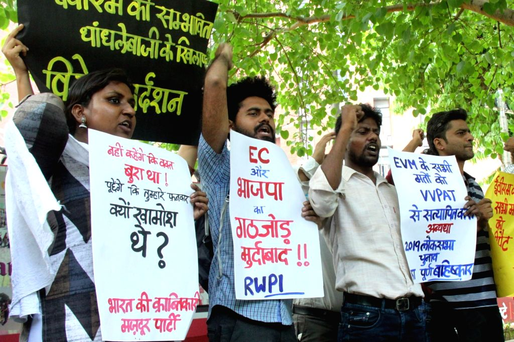 Revolutionary Communist Party of India (RCPI) workers stage a demonstration against the Election Commission of India (ECI) after a major controversy erupted over allegations that EVMs were ...
