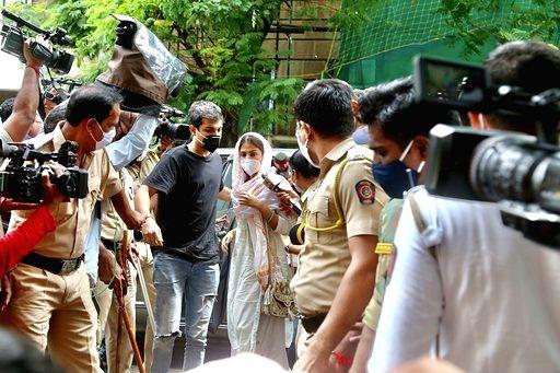 Rhea at CBI's with Mumbai Police as escort