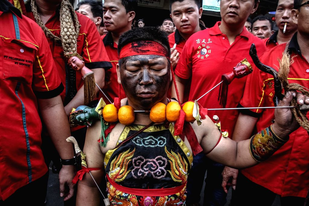 Indonesian Chinese people participate in the celebration of Chinese Lunar New Year Parade at Selat Panjang, Riau, Indonesia. Feb. 24, 2015.