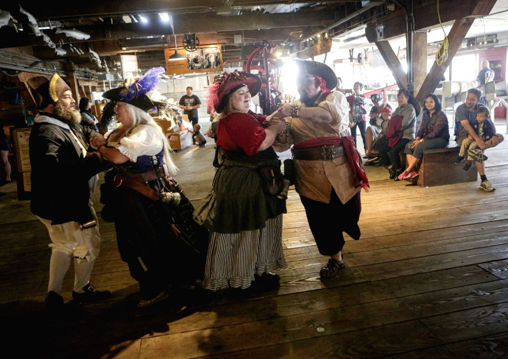 """RICHMOND(CANADA), Sept. 16, 2017 People dressed in pirate costumes dance during the """"Pirate Weekend"""" event at the Gulf of Georgia Cannery National Historic Site in Richmond, ..."""