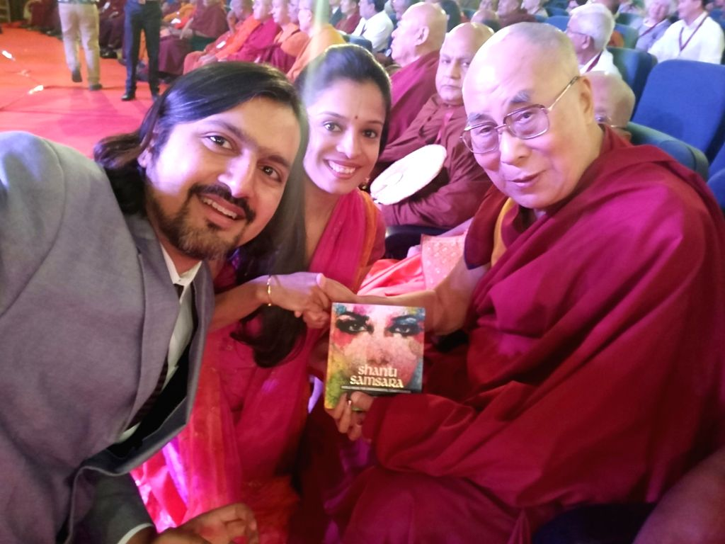 Ricky Kej presenting his album 'Shanti Samsara' to the Dalai Lama.