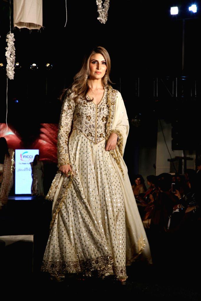 "Riddhima Kapoor Sahani, daughter of actor Rishi Kapoor, showcases fashion designers Abu Jani and Sandeep Khosla's creation during ""Khadi Goes Global"" programme, in New Delhi, on ... - Rishi Kapoor and Riddhima Kapoor Sahani"