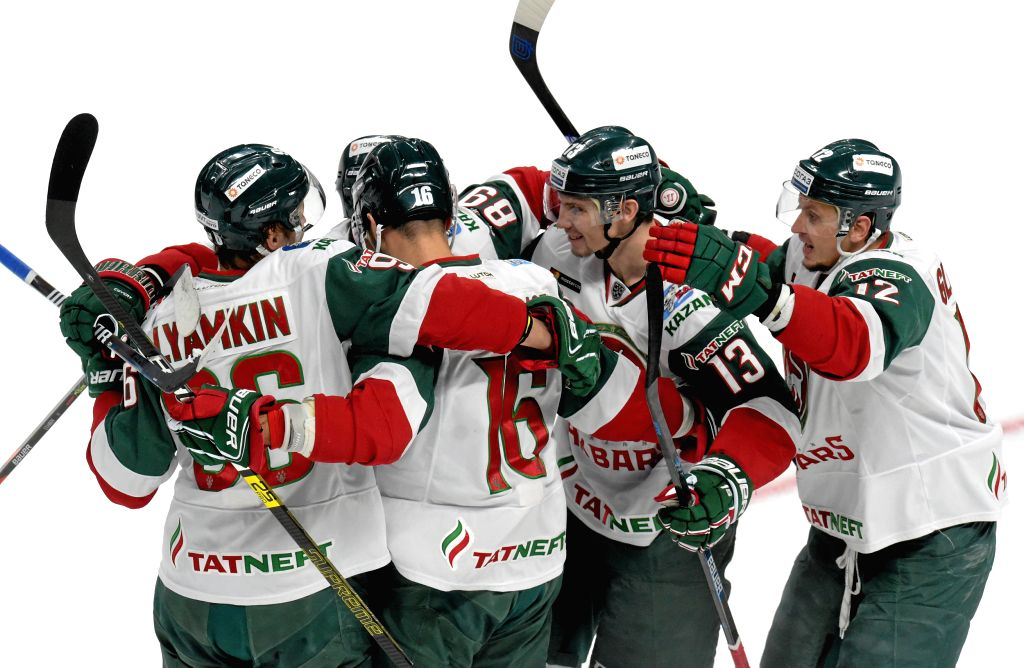 RIGA, Aug. 26, 2019 - Kazan Ak Bars players celebrate a goal during the 2019 Latvian Railway Cup ice hockey match between Riga Dinamo and Kazan Ak Bars in Riga, Latvia, Aug. 25, 2019.