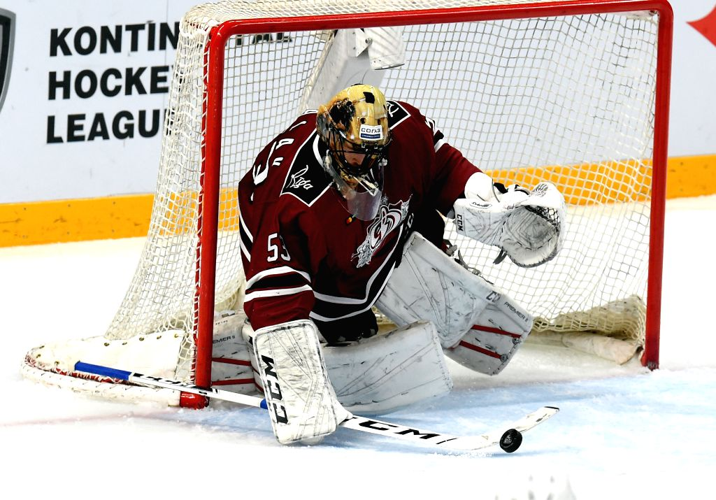 RIGA, Dec. 5, 2019 - Dinamo Riga's goalkeeper Alexander Salak tries to make a save during the 2019-2020 Kontinental Hockey League (KHL) ice hockey match between Dinamo Riga and Severstal Cherepovets ...