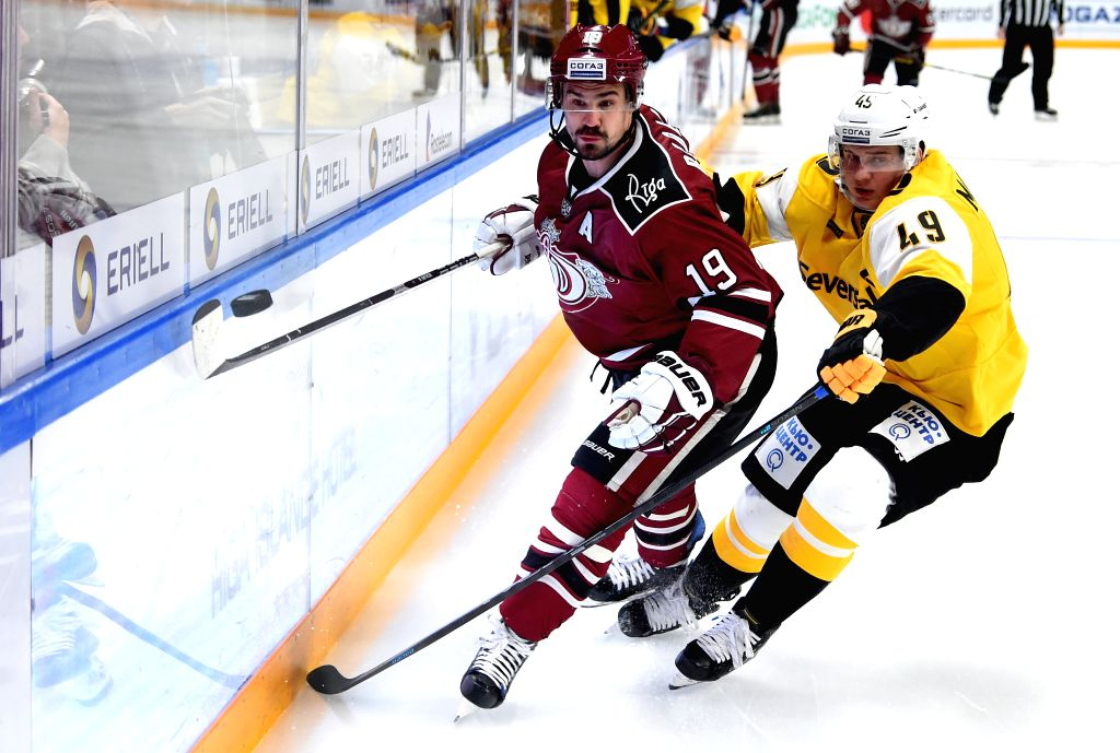 RIGA, Dec. 5, 2019 - Mikelis Redlihs (L) of Riga Dinamo vies with Dmitry Markovin of Cherepovets Severstal during the 2019-2020 Kontinental Hockey League (KHL) ice hockey match between Dinamo Riga ...