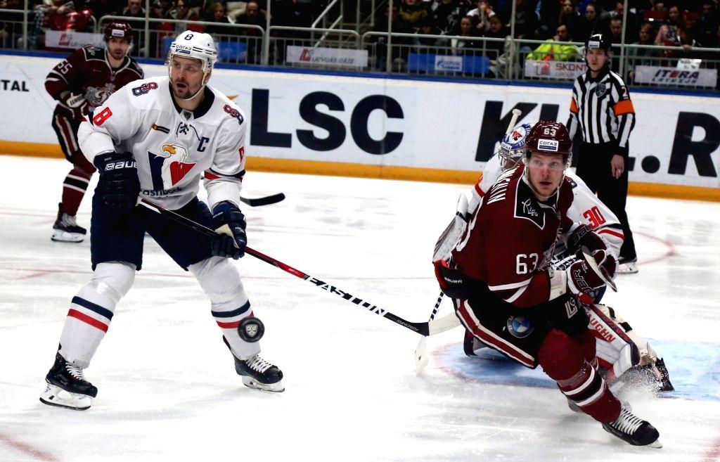RIGA, Feb. 19, 2019 - Dmitry Shulenin (R front) of Dinamo Riga vies with Michal Sersen (L front) of Slovan Bratislava during the 2018-2019 KHL ice hockey game in Riga, Latvia on Feb. 18, 2019. Dinamo ...